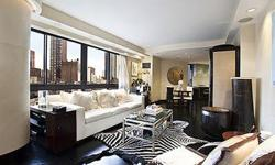 WebID 33341 Large corner 1 bed home with 1.5 Marble baths with Eastern and Northern views impeccably renovated by renowned interior designer.Apartment features well proportioned living room with floor to ceiling windows, balcony off living room. Brand new