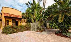 From the moment you enter the antique eight foot double entry doors into the courtyard of this custom home you will know you have arrived at a home unlike any other on Siesta Key. Leave the world behind and enjoy the water cascading from the grotto of the
