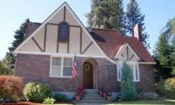 One & half blocks from popular Comstock Park and on the quieter West end of 29th. Clinker Brick Tudor w/complete remodel in kitchen,main bath, & all of first floor. Basement is all freshly painted. Master Suite has beautiful built-ins and own private bath