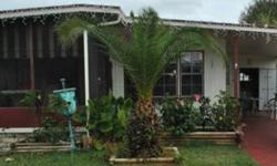 This is a 1976 double wide home with 840 sq.ft. It has 2 bedrooms and 2 bathrooms with 2 walk-in closets/ 1 hall closet. There is tile in the kitchen and restrooms, along with one year old wooden flooring through-out the home. This home includes a liani