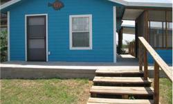Home located on the Colorado River in Matagorda just minutes from offshore Gulf of Mexico and Matagorda Bay fishing. Come and enjoy the beach fun with friends and family! Fishing pier with fish cleaning table. This home has wheelchair accessibility. Two