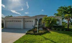 Lovely tropical landscaping and a faux paver porch welcome you to this gorgeous 2BR/2BA + Den home with spectacular view of large pond. Living and Dining Rooms are spacious and perfect for relaxing or entertaining. Dream Kitchen has new ceramic tile, love