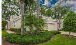 Looking for panoramic views of one of the most famous golf courses in the Tampa Bay area? Location is everything when it comes to Fox Hollow Golf Club; it is even better when the home is low maintenance. Located in the exquisite Peachtree gated subdivisio
