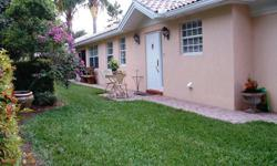 Come and enjoy Resort Living in this Island Walk DiVosta Capri Patio Home.Voted #1 in 2011!This attached villa home sits on an oversized corner lot with a natural fence barrier surrounding your yard, Western Exposure open patio to watch the sunset. New