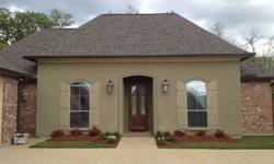 Beautiful CUSTOM BUILT home in Acadiana of Ascension with 4 bedrooms and 3 full baths. This beautifully landscaped home has a side load garage with separate storage space. The kitchen features a slab granite island, gas stovetop, custom Cypress cabinets