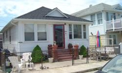 Trendy West End Cottage in Long Beach...Sold As Is!!!! Damaged by hurricane sandy..Calling all investors...Just one block to beach or bay..Near all stores...