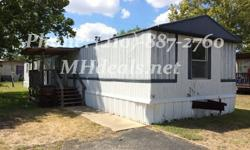 An extremely cheap single wide home in great condition. Comes with 3 bedrooms and 2 bathrooms. This home is a good size 1,216 square feet (16 x 76). Kitchen has a long storage island wall, with available supplies. In master bathroom you will get a corner