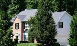 Two Story Brick Traditional located on a large wooded lot in a quiet lake community.Listing originally posted at http
