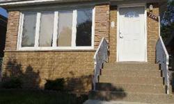 Charming, brick, 3bd/2ba, SFH in West Ridge!! This spacious home features