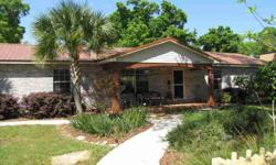 Great Home in East Pensacola Heights! With an open floor plan, the spacious kitchen and dining area overlook the serene, low maintenance, (xeriscape) professional landscaped back yard which has an open patio, a 14x14 deck made of Brazilian Teak and an