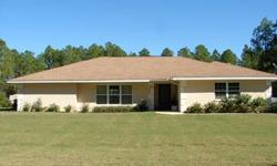home is on canal that leads to largest lake in polk county (7,500 acres). 2 boat slip dock house, private boat ramp on property. pool is solar heated. one half acre lot.