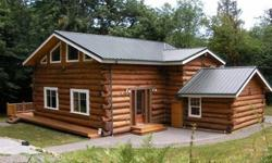 REDUCED PRICE! Welcome to Hanstad Creek Lodge nestled in the trees near the creek offering the ideal country retreat. This quality built log home features all the comforts of modern housing with the peace, quiet & seclusion of the country.An open floor