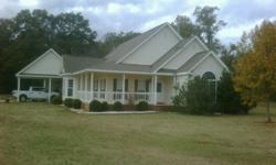 Located in the Daniel Pratt School District on 6 acres with the house nestled toward the back of the lot.