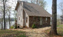 This custom built house is perfect as a vacation home, a retirement home or just a home for someone who likes the refined/rustic look of wood and stone. This picturesque Adirondack style home appears like a one story from the street and a 3 story