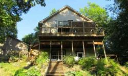 One of a kind Lake Home find! This lake home offers a private & peaceful setting (.69 acre) with 100 ft of Lake Freeman frontage & has been tastefully renovated. Renovations include new kitchen, bamboo floors, upstairs master bedroom, bathrooms, walk-out