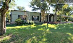 Quiet Wooded Sanctuary on 16.57 acres with a unique and lovely home that will delight you. 2322 Sq Ft, 3 Bedrooms, 2 Bathrooms.2 large living areas, one with large fireplace, the other could be used as a bedroom with bow windows and great window seat.