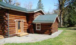 Welcome to Hanstad Creek Lodge nestled in the trees near the creek offering the ideal country retreat. This quality built log home features all the comforts of modern housing with the peace, quiet & seclusion of the country.An open floor plan provides the
