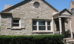 3 bedroom-2 bath English home with 2 fireplaces, full basement with knotty pine paneling. Central air, EE GFA. Walking distance to Metra.
