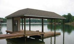 Level waterfront lot with new covered boathouse and floater w/cabana. 1.39 acres and 100' of WF. Letter for 3 bedroom pumpback septic permit. Price reduced $40,000.00.Listing originally posted at http
