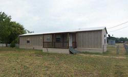 Affordable country living! Two Bedroom, Two Bath manufactured home features spacious living, split bedrooms, large glassed in rear porch plus covered front porch, Wylie Schools, too!! Property is being sold 'as-is' and is subject to HUD Guidelines 14 CFR