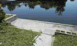 Waterfront, Gulf access, paved driveway and a cabana. Previously had a single wide mobile home.Listing originally posted at http
