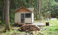 This 1 room cabin has expansion capabilities for up to 2-three beds has water, an lp stove & refrigerator, wood stove, 5kw generator for electrical power, a double hide-a-bed, & is wired for telephone.