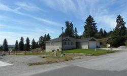 Incredible rancher on almost a half acre ready for a shop, with three bedrooms on the main floor. The Basement is finished with two bedrooms, a bath, a family room, hardwood floors, a den all daylight walkout. The master suite has a full bath and a great