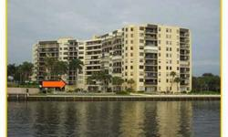 Completely updated direct Intracoastal waterfront condo with new appliances, granite, impact windows, designer window treatments. Sellers added the windows, a/c and window treatments since purchasing.Two large split plan master suites in this amazing