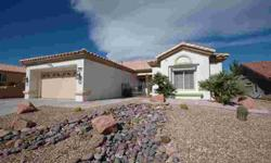 """This lovely Tahoe model is a very popular open Sun City Summerlin floor plan that many buyers love. This home has amenities galore; remodeled kitchen with custom cabinets, stainless appliances, crown molding and 4"""" base boards, plantation shutters,"""