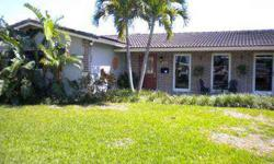 Extremely desirable family oriented neighborhood, Beautifully Remodeled home, move in ready, Large screened in patio overlooking pool, professionally landscaped yard. Please confirm school boundaries at broward schools dot com THIS LISTING COURTESY OF