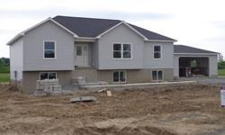 Brand New Raised Ranch in new sub division. Home features 5 bedrooms and 3 baths. 1.5 acre lot next to school. Hot water baseboard heat On demand hot water heater. Hardwood and tile floors. Master bedroom.