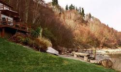 Quintessential Whidbey Island no bank waterfront cabin. Year originally built is unknown but has been remodeled in 1990 through present day. Absolutely the best location on this beach! Private, tranquil setting. Superior coastline views. Year round sandy