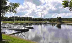 LOCATION AND VIEW...No detail has been overlooked in this beautiful Quarry condo -- overlooking a large lake this first floor unit has it all. From the gourmet kitchen that features granite counters, stainless steel appliance, custom lighting to the