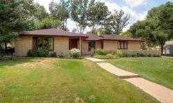 Charming Brick Ranch Across From Park & Open Space--One Of A Kind Location. Beautiful & Open Interior With Wood Floors. Well Maintained Home With New Roof & Newer Windows. Spacious Deck & Private Yard. Corner Lot, Country Like Setting.Listing originally