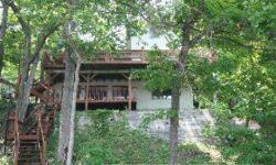 Well cared for home in a very nice neighborhood. This is a view that most seek out, with morning sun and afternoon shade on the lake side, cove location with the main channel view. The master suite is on the top floor, but there are two additional