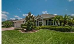 MODEL PERFECT 3Br/3Ba + Den + Bonus home on large conservation lot. A paver drive/porch, lovely tropical landscaping and leaded glass doors welcome you to this extraordinary residence. Stunning real hardwood floors in Foyer, Dining room, Living/Great room
