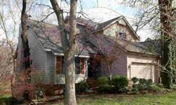 Spacious waterfront home in gated community! Lg. family rm w/vaults, knotty pine ceiling, built ins, wall of windows, wood burning FP. Sitting area has FP w/gas logs. 4th BR could be office. Master with sitting area, his/her closets. Walkout