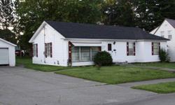 ranch home, 2 car garage, an 3 season screen room, full basement, circuit breakers, partial new roof, 1319 sq.ft. living space, large level lot, with garden spot, needs little tlc, everything is up an running an clean. Price change, $28000 land contract
