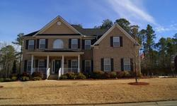 Welcome Home!!! This gorgeous brick home features heavy moldings & wainscoting, hardwoods and carpet throughout main floor. Which features a spacious kitchen & eat-in area that opens to the great room, formal living room and dining room and the fifth