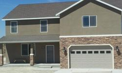 Beautiful new construction in Spring Creek. 5 bed 3 bath 2800 Sq ft. Granite, tile and all appliances. Stucco exterior. Home is framed and ready for you to pick your interior colors. Call Vicki Lloyd Century 21 Gold West Realty 775-934-3605 for a personal