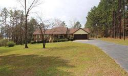 Beautiful. level waterfront lot is over two acres with a picture perfect view of the fishing lake. Spacious home has been well cared for by this sweet couple. Two living areas, large sunroom, office, sewing or hobby room, three bedrooms, three bathrooms,