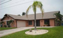 This wonderful 4 bedroom, 2 bath Gulf access home has everything you need to enjoy true South Florida living. Walk through the screened entry way, throw open the double doors and immediately see the view of the pool and waterway. Enjoy the pool and expan