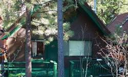 The setting is everything! Freestanding home on year-round stream with thoughtfully landscaped yard in front and back. Two decks to enjoy the Lake Tahoe lifestyle. Inside warm yourself by the woodstove and relax!Listing originally posted at http