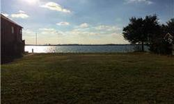 One of the few OPEN waterfront lots left on Lake Conroe. Come build your dream home! Access controlled community that offers tennis courts, boat launch, and community pool.