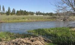 Build your new dream home on this beautiful Water Front property located on the Little Spokane River. Just shy of 3 flat acres that roll right into your very own 260 feet of water frontage. Located in the Mead school district with easy access off of