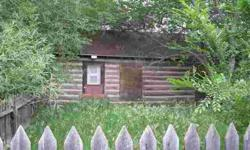 Old log cabin that has one room plus a bath. Would be vacation spot or hunting cabin. Bathroom has been added. Cabin is just log and chinked with no insulation. Rough flooring in one room. Old shed included with old trees on lot.Listing originally posted