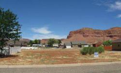 This very nice building lot is located in a great area of Kanab with beautiful views of the Vermillion Cliffs. You can build a starter home or your dreamhouse on this 1/4 acre parcel. All utilities are available at the lot PLUS you will be connected to