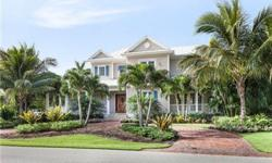 """This is one of the best """"newer"""" home waterfront opportunities available in Naples today! Classic Old Florida architecture. Features include a gourmet kitchen with Viking appliances, hard wood floors, two fireplaces, French doors, wraparound porches, 2 b"""