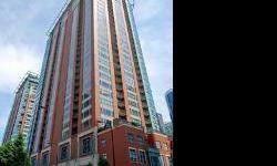 VIEWS! Rarely on market. South views of river and lake, East views of Navy Pier, North views of city. 3 bed plus large den. 3.1 bath, 2 balconies. Kitchen is beautiful & wide w/extra breakfast table built-in. Dual sided fireplace w/ custom mademantel &