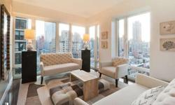 This unique and well-priced 3 bedroom, 3 full bath condominium residence featuring a fabulous designer kitchen equipped with a wine cooler and top-of-the-line appliances such as Sub-Zero and Viking. The bathrooms have deep soaking tubes, radiant heated